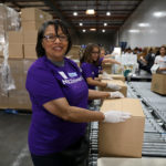 NBC Universal volunteers on production line at the Food Bank's studio day 2018
