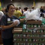 Action team with canned food at LA Food Bank