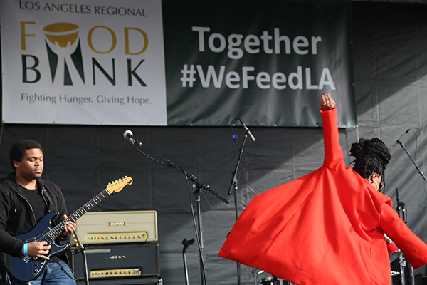 Band on stage under Food Bank banner
