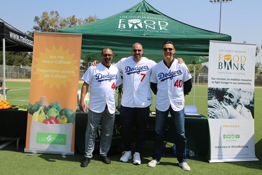 Dodgers Alumni vist the CalFresh Outreach booth at Dodger Days Youth Clinic at Ross Snyder Park