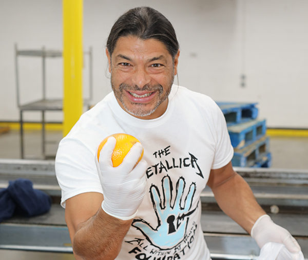 Robert Trujillo volunteers at the Los Angeles Regional Food Bank for the second time.