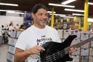 Robert Trujillo holding signed Metallica guitar