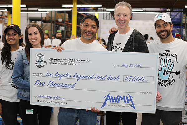 Robert Trujillo presents the Los Angeles Regional Food Bank with a check for $5,000.