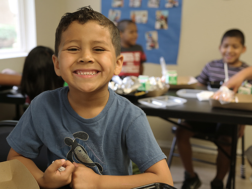 Young boy at Summer Lunch Program.