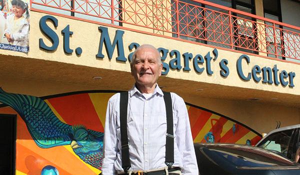 Wayne standing in front of St. Margaret's Center