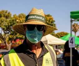 Los Angeles Regional Food Bank employee at an emergency free food giveaway distribution.
