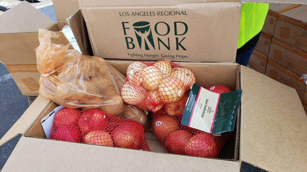 Onions, apples and potatoes are at a drive-through distribution hosted by the LA Regional Food Bank.
