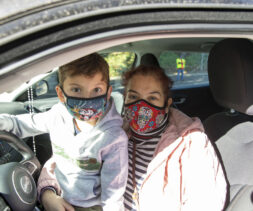 Mother and son in car at a drive-through distribution hosted by the LA Regional Food Bank