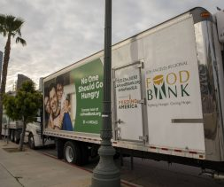 The LA Regional Food Bank truck at a drive-through food distribution.