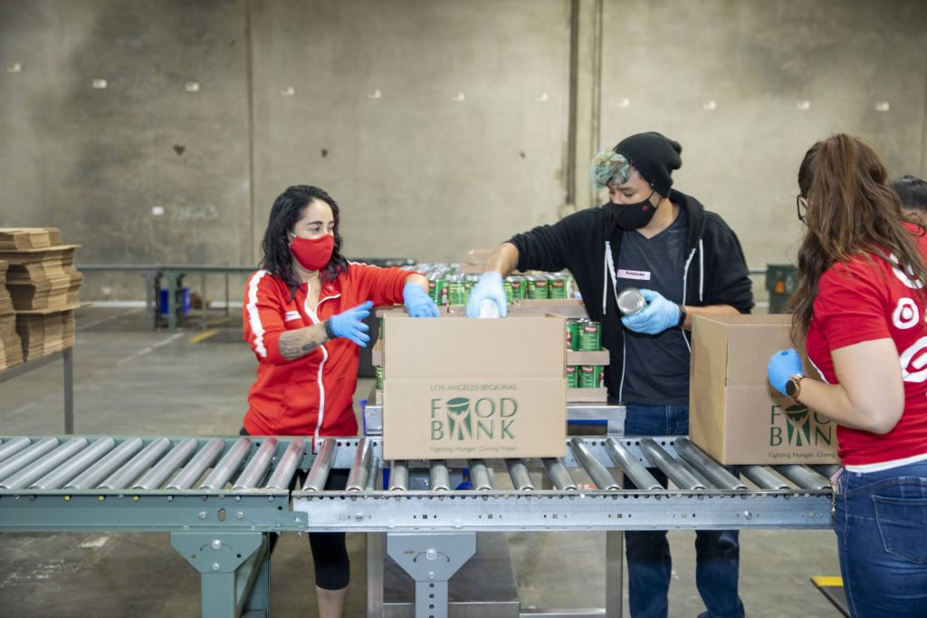 Volunteers from Target and UCLA prepare food kits in the LA Regional Food Bank warehouse in South LA.