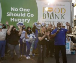 A group of people cheer on ABC7 at the 10th Annual Feed SoCal event with the LA Regional Food Bank.