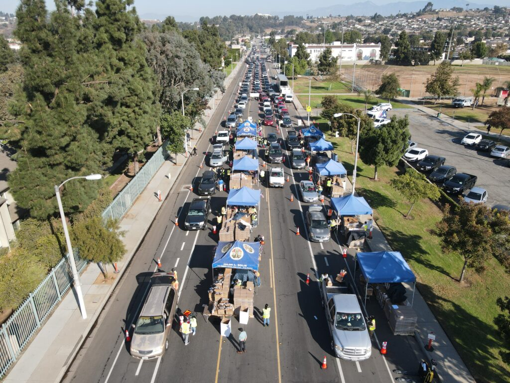 An aerial view of a Los Angeles Regional Food Bank drive through food distribution for those in need of food assistance.
