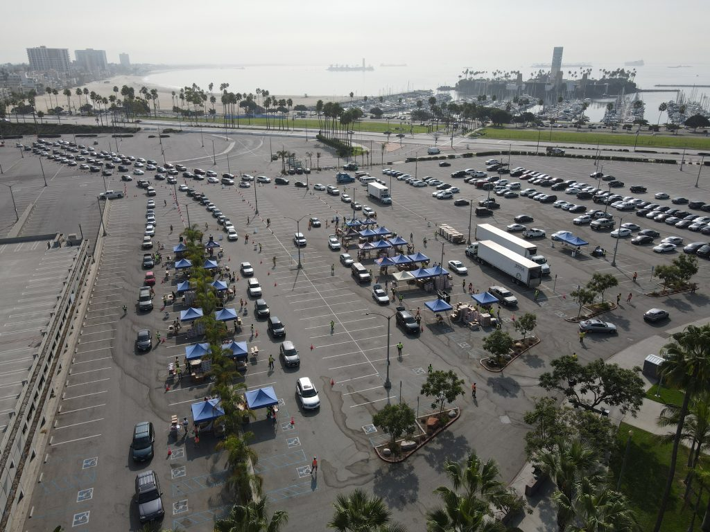 An aerial shot of a drive-through food distribution in Long Beach, CA.