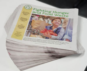 stack of fighting hunger and food waste newspapers