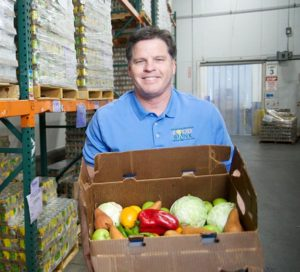 Michael Flood CEO Food Bank with produce