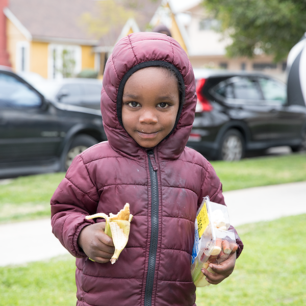 Young boy outside My Friends House distribution.