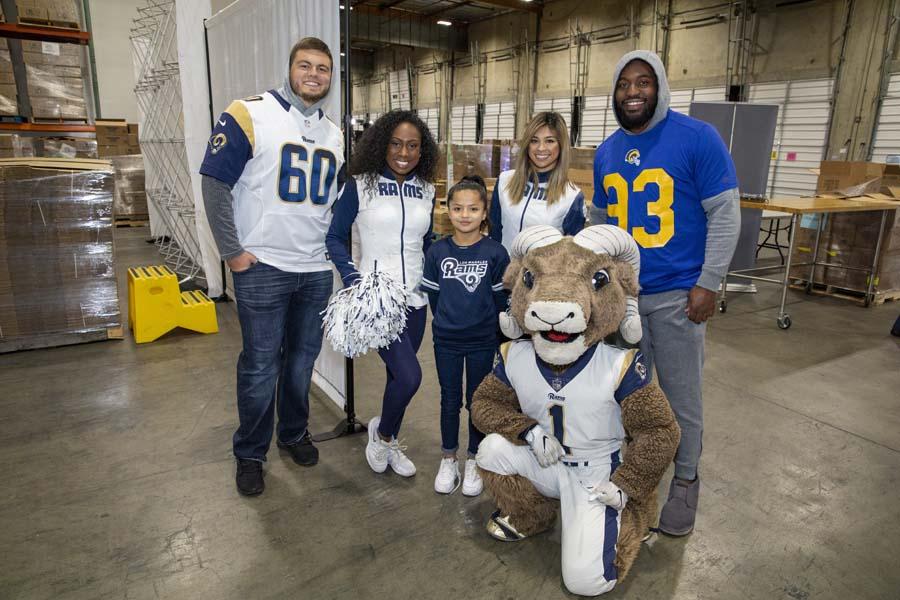 Rams players cheerleaders and mascot