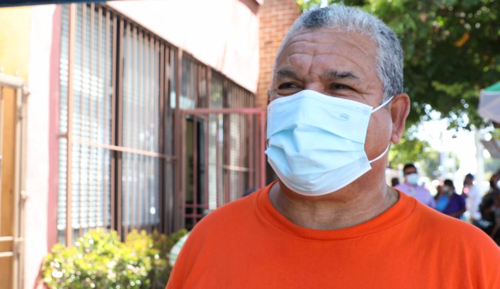 A close up of a volunteer wearing orange at a LA Regional Food Bank partner agency in West Los Angeles.
