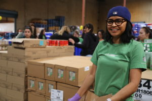 Starbucks partner packaging food at the Los Angeles Regional Food Bank