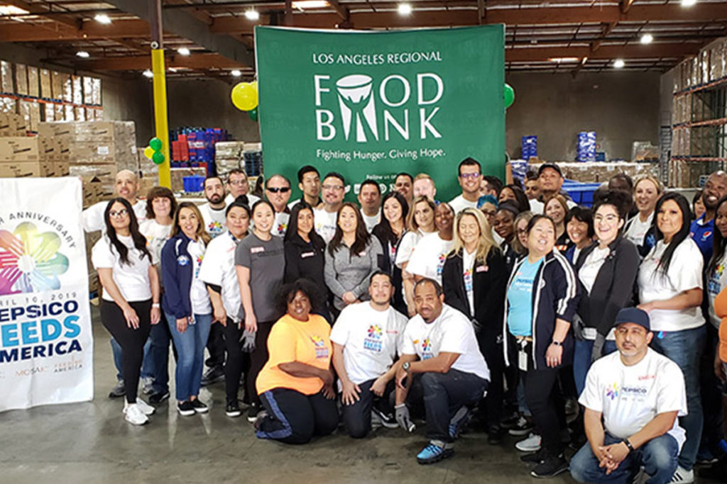 group of volunteers gathered in a warehouse